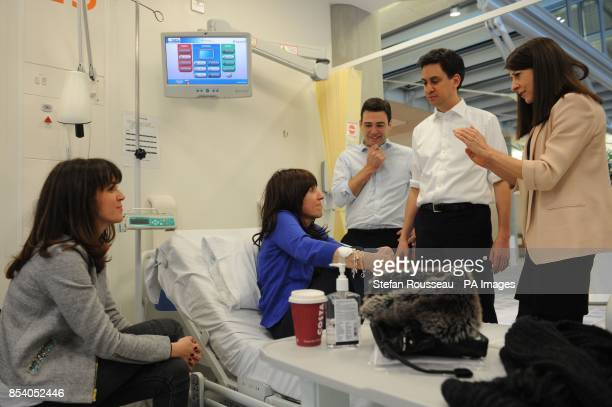 Labour leader Ed Miliband shadow health minister Liz Kendall and shadow health secretary Andy Burnham meet patients at the Macmillian Cancer Centre...