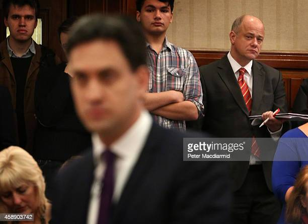 Labour Leader Ed Miliband speaks as aide Bob Roberts listens at Senate House on November 13 2014 in London England Mr Miliband's leadership has been...