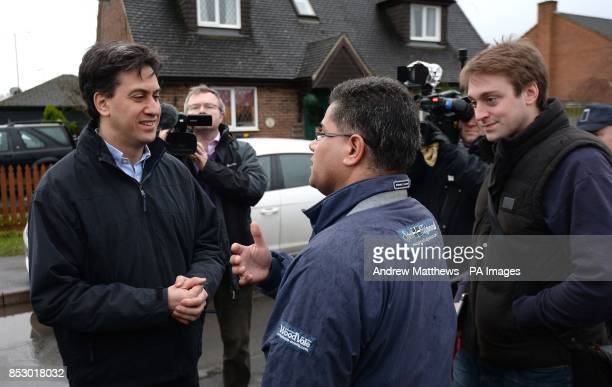 Labour leader Ed Miliband speaks with Alok Sharma MP for Reading West during a visit to view recent flooding in Purley on Thames in Berkshire