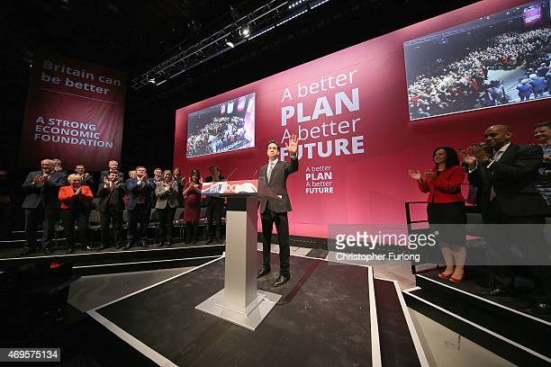 Labour leader Ed Miliband waves to the audience after launching his party's general election manifestot at the Old Granada TV studios on April 13...