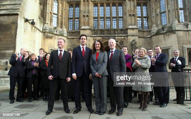 Labour leader Ed Miliband welcomes his new MPs Steve Reed Sarah Champion and Andy McDonald as they arrive at the House of Commons after winning their...