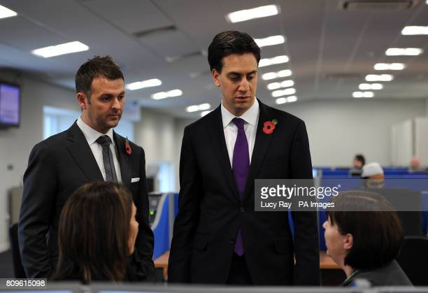Labour Leader Ed Miliband with Daisy Group CEO Matthew Riley as he speaks to Customer Service Advisors during a visit to the headquarters of the...