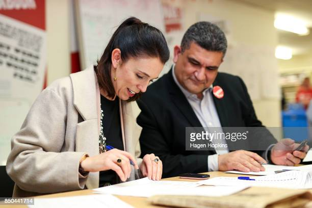 Labour leader Jacinda Ardern makes calles with Rongotai candidate Paul Eagle during a visit to Eagle's phone bank on September 21 2017 in Wellington...