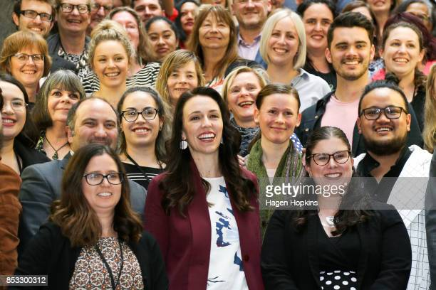 Labour leader Jacinda Ardern poses with staff members prior to an announcement for Labour's new provisional caucus members at Parliament on September...