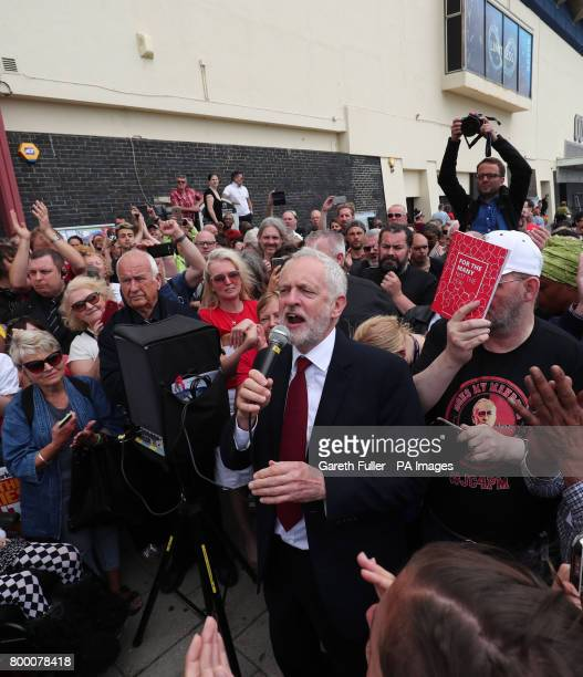 Labour leader Jeremy Corbyn addresses supporters outside the Unison annual conference at the Brighton Centre in East Sussex