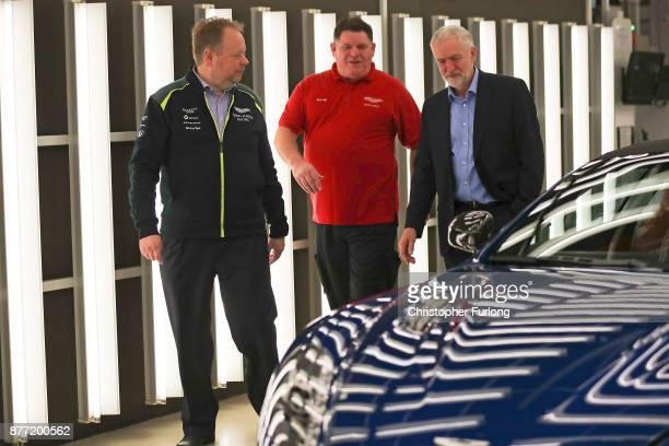 Labour Leader Jeremy Corbyn and Andy Palmer CEO of Aston Martin talk to quality inspector Barry Griffin during a visit to luxury car maker Aston...