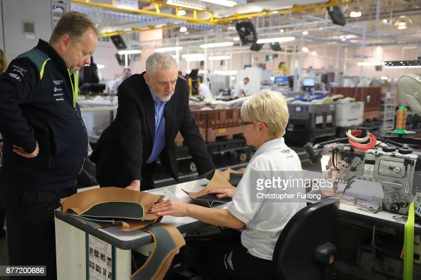Labour Leader Jeremy Corbyn and Andy Palmer CEO of Aston Martin talk to trim worker Gwyneth Hanson during a visit to luxury car maker Aston Martin on...