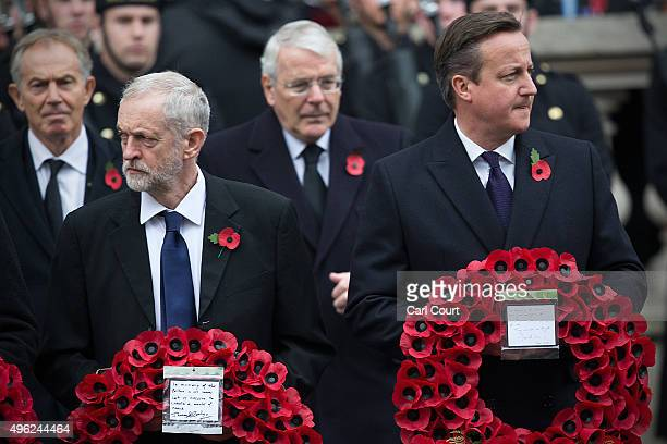 Labour leader Jeremy Corbyn and British Prime Minister David Cameron attend the annual Remembrance Sunday Service at the Cenotaph on Whitehall on...
