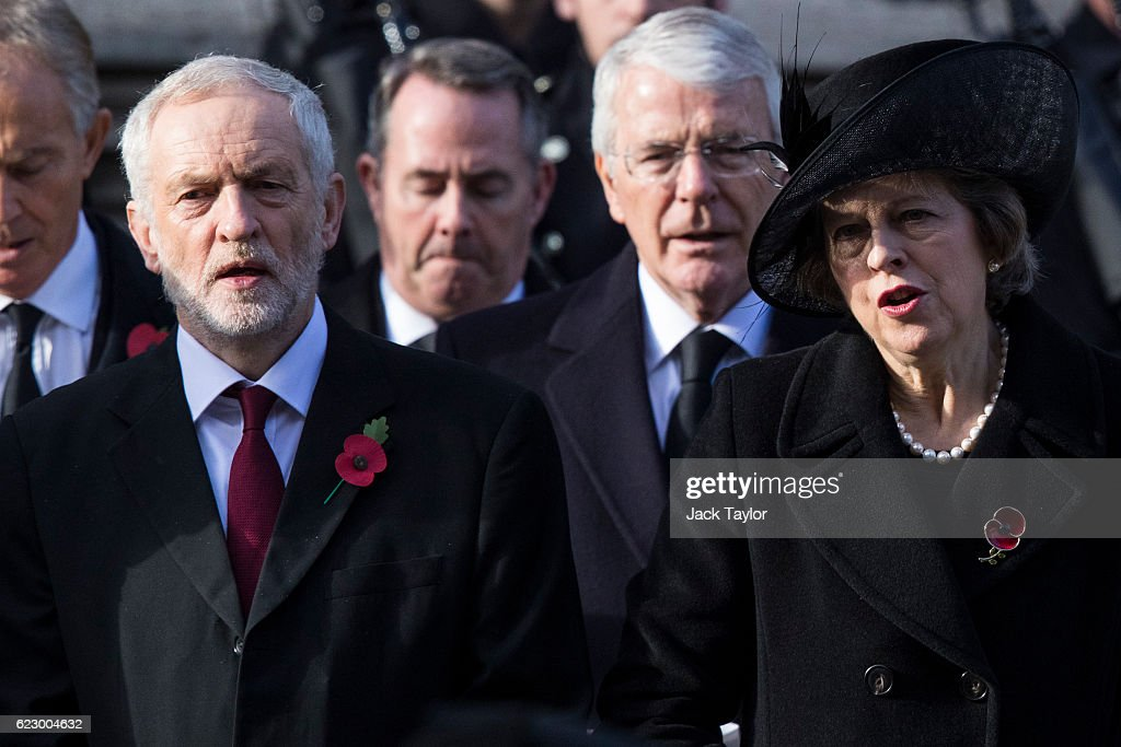 Labour Leader Jeremy Corbyn and British Prime Minister Theresa May sing the national anthem during the annual Remembrance Sunday Service at the Cenotaph on Whitehall on November 13, 2016 in London, England. The Queen, senior politicians, including the British Prime Minister and representatives from the armed forces pay tribute to those who have suffered or died at war.