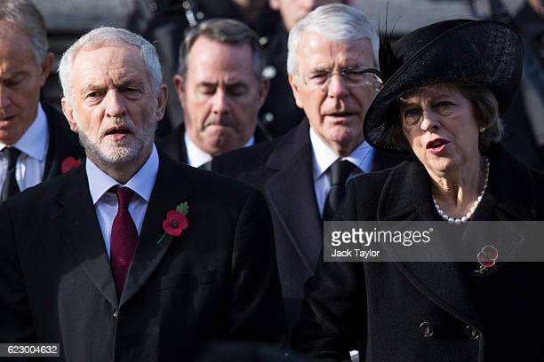 Labour Leader Jeremy Corbyn and British Prime Minister Theresa May sing the national anthem during the annual Remembrance Sunday Service at the...