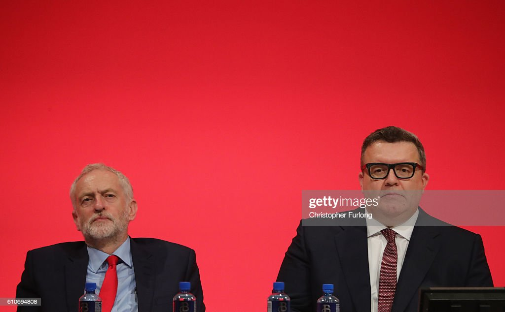 Labour leader Jeremy Corbyn (L) and Deputy leader of the Labour party, Tom Watson, lisen to a speaker during the third day of the Labour party conference at the ACC on September 27, 2016 in Liverpool, England. On day three of the annual conference Shadow Education Secretary Angela Rayner set out the party's policy on childcare while deputy leader Tom Watson delivered his keynote speech to delegates calling for unity within the party.
