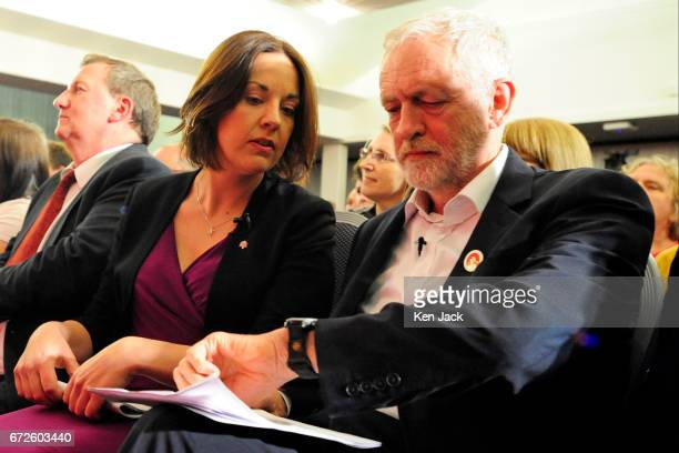 Labour leader Jeremy Corbyn and Scottish Labour leader Kezia Dugdale check the time as they sit together before making general election campaign...
