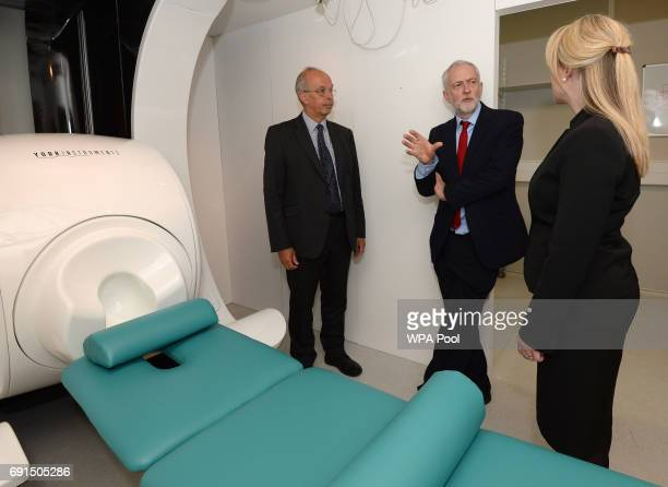 Labour leader Jeremy Corbyn and Shadow Business Secretary Rebecca LongBailey are shown an MRI scanner by Professor Gary Green during a tour of the...