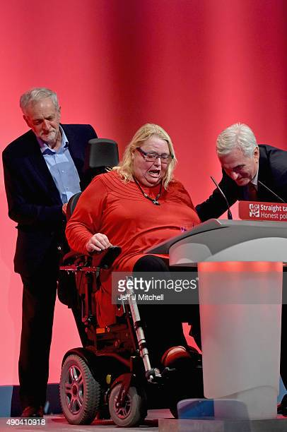 Labour leader Jeremy Corbyn and Shadow chancellor John McDonnell help former Islington Mayor Sandy Marks of stage during the morning session at the...