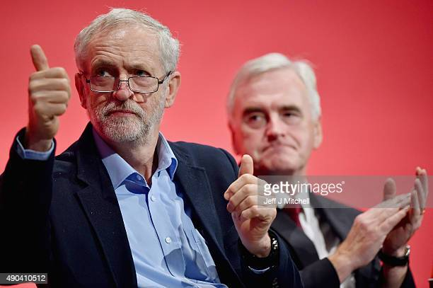 Labour leader Jeremy Corbyn and Shadow chancellor John McDonnell sit on stage during the morning session at the Labour Party autumn conference on...