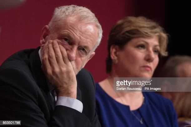 Labour leader Jeremy Corbyn and shadow foreign secretary Emily Thornbury listen to speeches at the Labour Party annual conference at the Brighton...