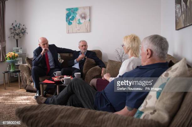 Labour leader Jeremy Corbyn and shadow housing minister John Healey as they speak with Don and Marilyn Bashford who have recently been rehomed in a...