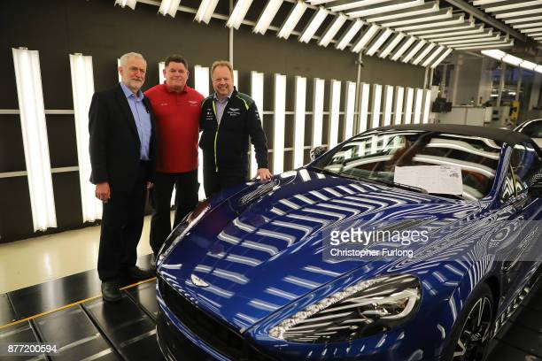 Labour Leader Jeremy Corbyn Andy Palmer CEO of Aston Martin and quality inspector Barry Griffin pose for a photograph during a visit to luxury car...