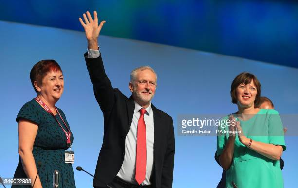 Labour leader Jeremy Corbyn arrives on stage at the TUC conference at the Brighton Centre in Brighton