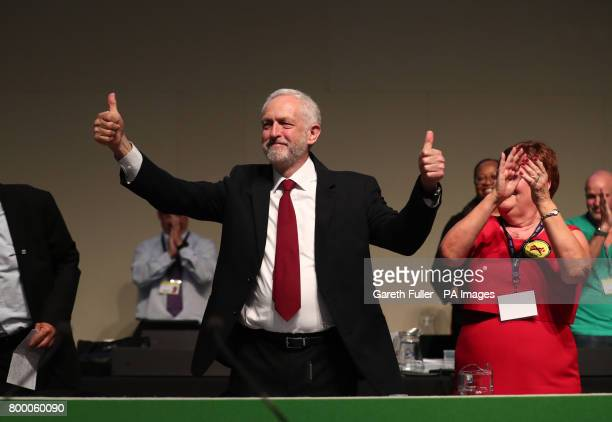 Labour leader Jeremy Corbyn arrives on stage to speak during the Unison annual conference at the Brighton Centre in East Sussex