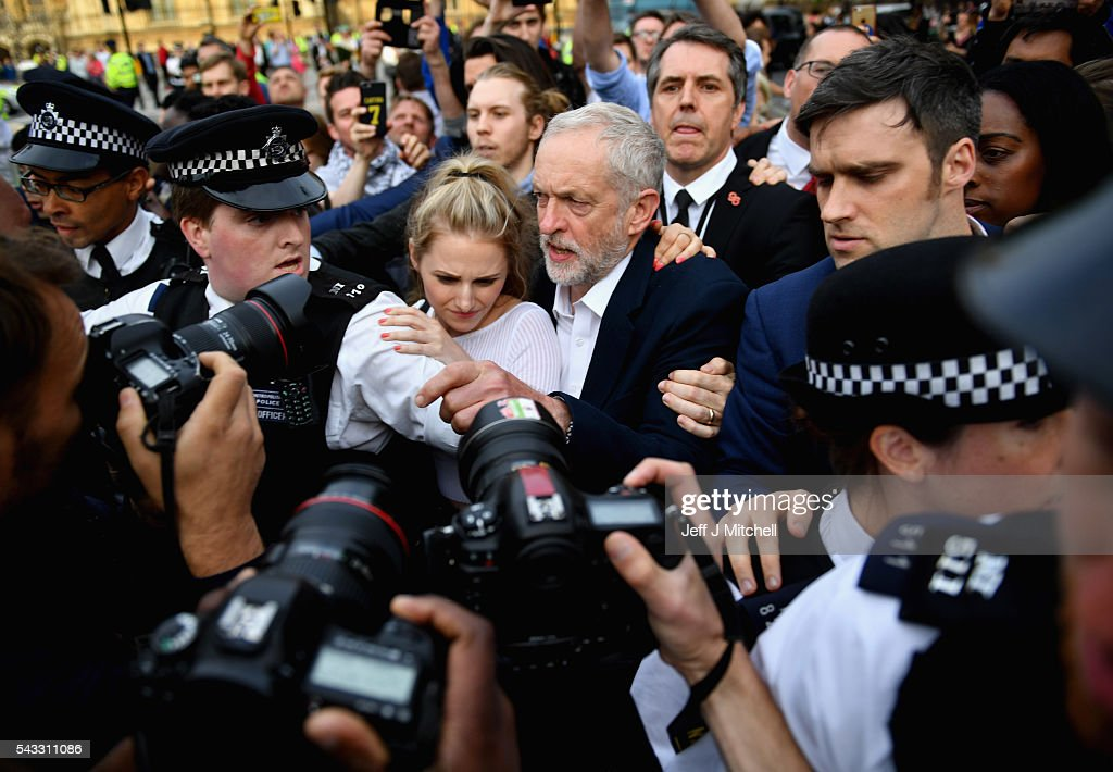 Labour leader <a gi-track='captionPersonalityLinkClicked' href=/galleries/search?phrase=Jeremy+Corbyn&family=editorial&specificpeople=2596361 ng-click='$event.stopPropagation()'>Jeremy Corbyn</a> arrives to deliver a speech during Momentum's 'Keep Corbyn' rally outside the Houses of Parliament on June 27, 2016 in London, England. The Labour Leader has seen mass resignations from the Shadow Cabinet in the wake of the UK Vote for Brexit. His support group, Momentum, have recorded more than 1000 new members in the same period.