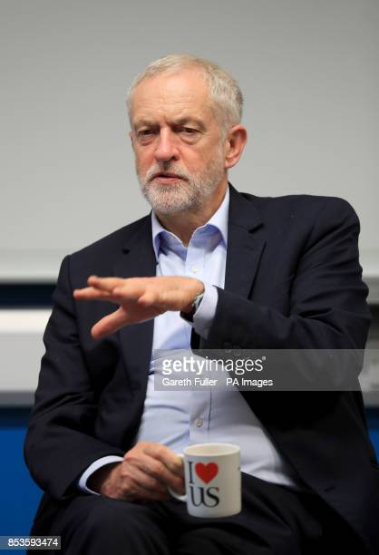 Labour leader Jeremy Corbyn drinks a cup of tea as he meets students on a visit to the University of Sussex during the Labour Party conference in...