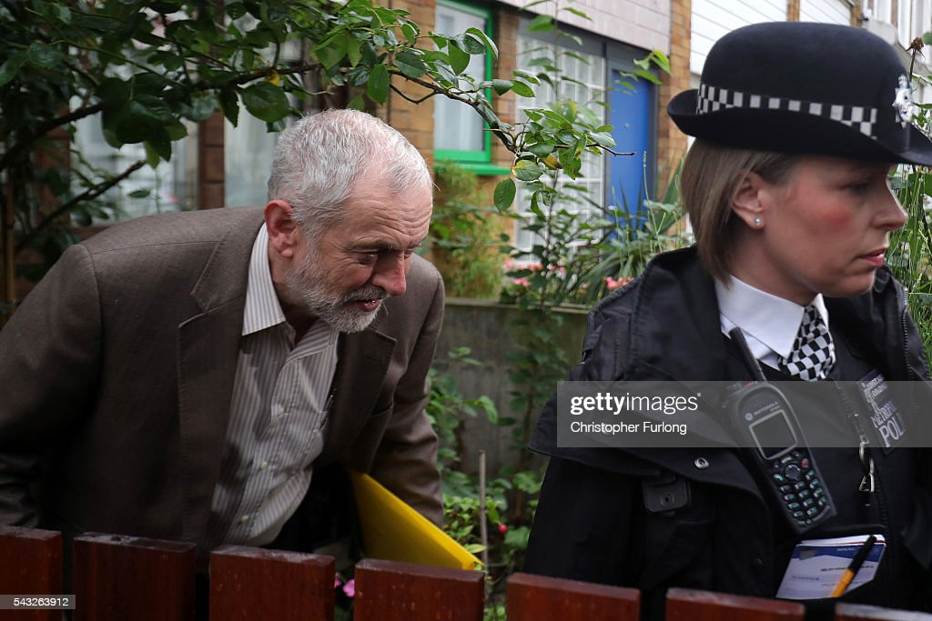 Labour Leader Jeremy Corbyn, ducks under his overhanging rose tree, as he leaves his home in North London amid a raft of resignations from his shadow cabinet on June 27, 2016 in London, England. In the wake of shadow foreign secretary Hilary Benn being fired at the weekend by Corbyn a string of other shadow cabinet members have resigned.
