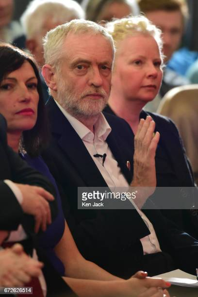 Labour leader Jeremy Corbyn gestures as he sits in the audience before making a general election campaign speech at a Labour Party event on April 24...
