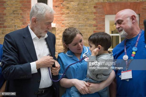 Labour leader Jeremy Corbyn has his heart listened to by 2yearold Haroon after he met NHS nurses student nurses and midwives to discuss Labouracircs...