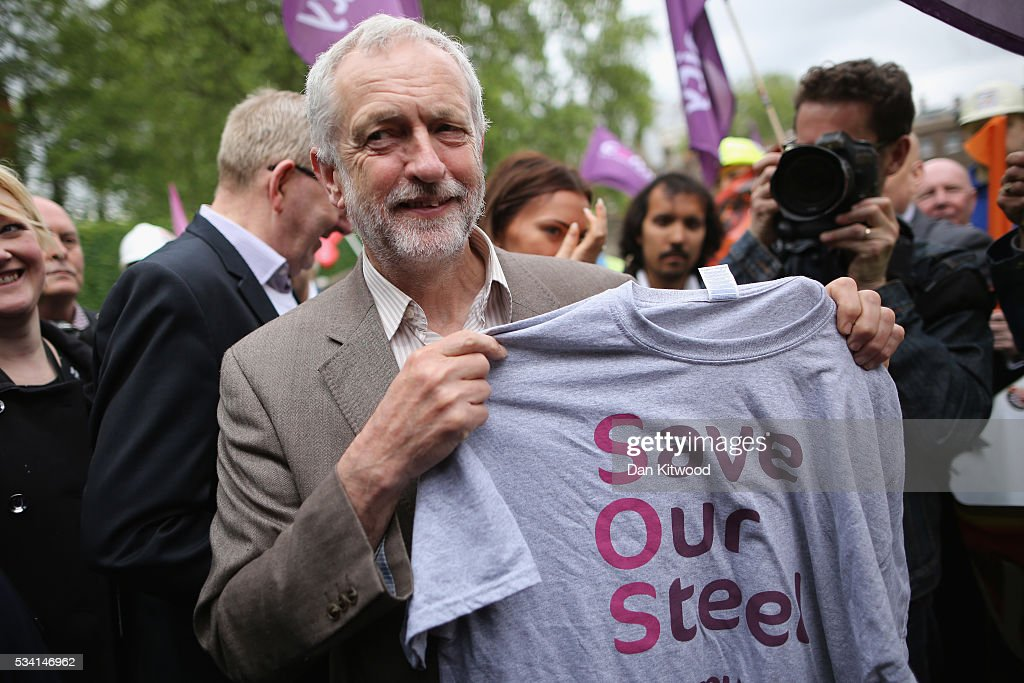 Labour leader <a gi-track='captionPersonalityLinkClicked' href=/galleries/search?phrase=Jeremy+Corbyn&family=editorial&specificpeople=2596361 ng-click='$event.stopPropagation()'>Jeremy Corbyn</a> holds a t shirt with the slogan'Save Our Steel' as he join steels workers on college green at the end of a march through Whitehall on May 25, 2016 in London, England. Steelworkers marched through Westminster today to highlight the crisis in the steel industy. A shortlist of bidders is currently being drawn up for the UK assets of Tata Steel.