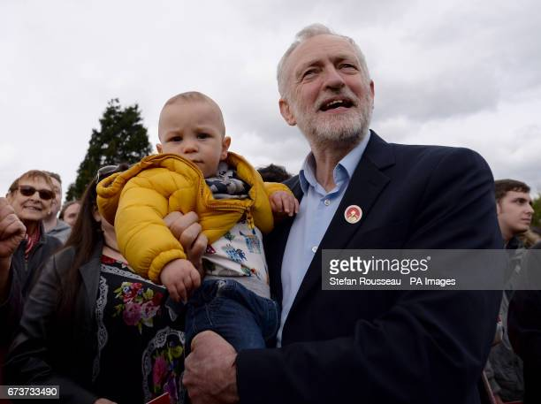 Labour leader Jeremy Corbyn holds oneyearold Angelo after speaking to supporters at a rally in Harlow