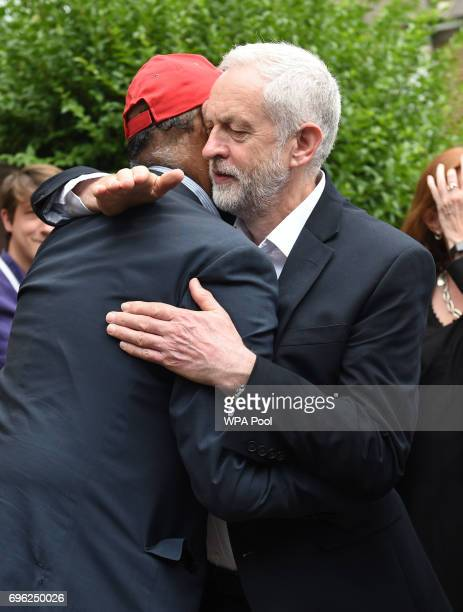 Labour leader Jeremy Corbyn hugs councillor Mushtaq Lasharie as he arrives at St Clement's Church in west London where volunteers have provided...