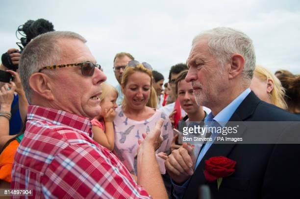 Labour leader Jeremy Corbyn is greeted by supporters as he visits the West Cliff area of Bournemouth for a walk along the beach that was cut short...