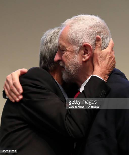 Labour leader Jeremy Corbyn is greeted on stage by Dave Prentis General Secretary of Unison before speaking at the Unison annual conference at the...