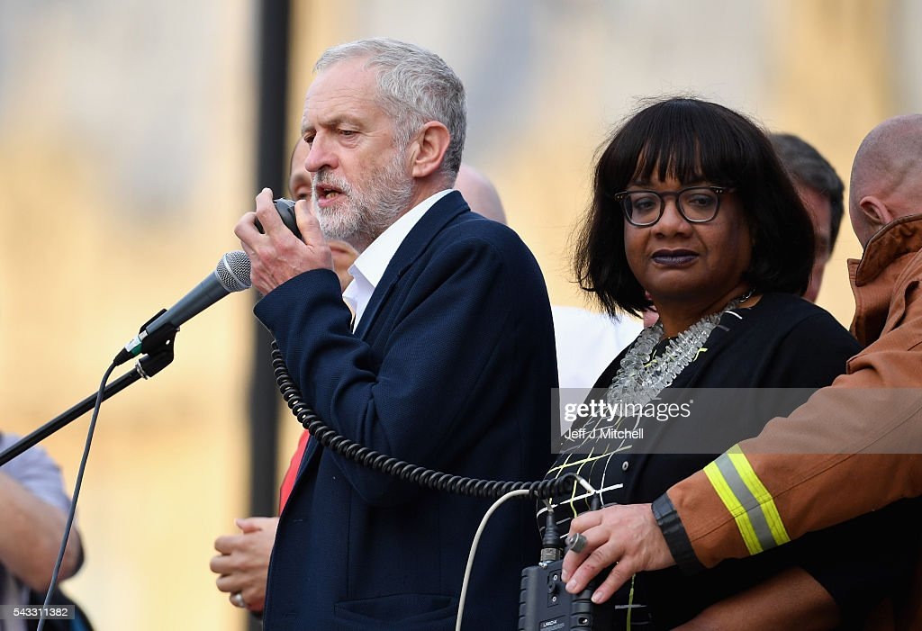 Labour leader <a gi-track='captionPersonalityLinkClicked' href=/galleries/search?phrase=Jeremy+Corbyn&family=editorial&specificpeople=2596361 ng-click='$event.stopPropagation()'>Jeremy Corbyn</a> is joined by Shadow Health Secretary <a gi-track='captionPersonalityLinkClicked' href=/galleries/search?phrase=Diane+Abbott&family=editorial&specificpeople=628753 ng-click='$event.stopPropagation()'>Diane Abbott</a> as he delivers a speech during Momentum's 'Keep Corbyn' rally outside the Houses of Parliament on June 27, 2016 in London, England. The Labour Leader has seen mass resignations from the Shadow Cabinet in the wake of the UK Vote for Brexit. His support group, Momentum, have recorded more than 1000 new members in the same period.
