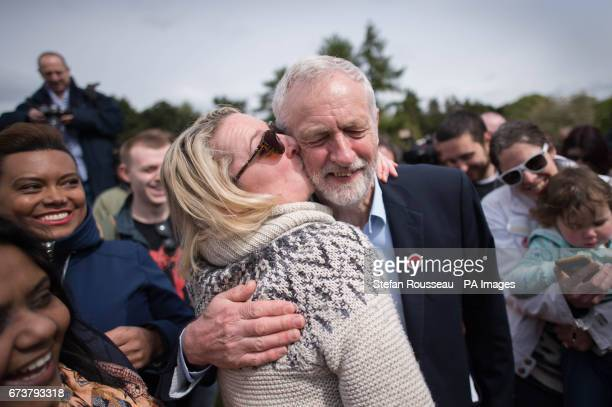 Labour leader Jeremy Corbyn is kissed by a supporter at a rally in Harlow Essex