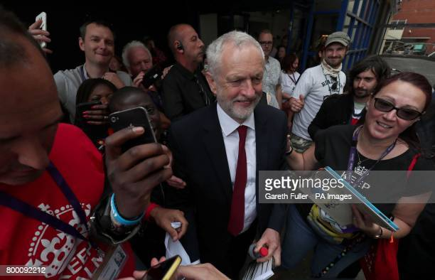 Labour leader Jeremy Corbyn is mobbed by supporters as he leaves the Unison annual conference at the Brighton Centre in East Sussex