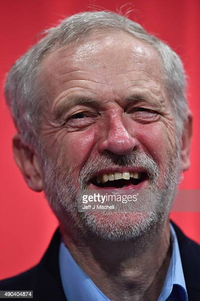 Labour Leader Jeremy Corbyn laughs as he listens to the morning session at the Labour Party autumn conference on September 28 2015 in Brighton...