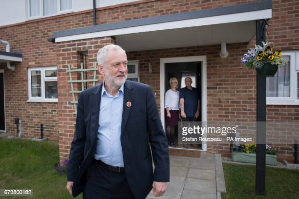 Labour leader Jeremy Corbyn leaves after talking with with Don and Marilyn Bashford who have recently been rehomed in a council house in Harlow Essex