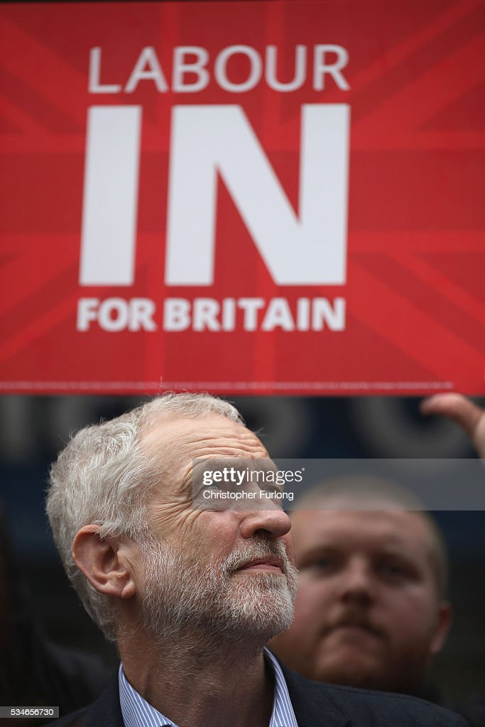Labour Leader Jeremy Corbyn listens as former leader Ed Miliband addresses supporters and members of the public in Doncaster town centre on May 27, 2016 in Doncaster, England. The Labour In campaign battle bus arrived in Doncaster today with Labour leader Jeremy Corbyn and Ed Miliband MP to canvass for votes and hope to persuade UK citizens to stay in the European Union when they vote in the EU Referendum on the June 23.