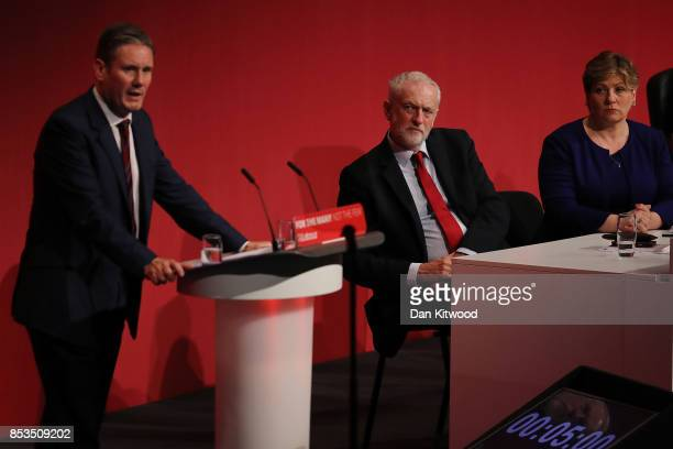 Labour Leader Jeremy Corbyn listens as Shadow Secretary of State for Exiting the European Union Kier Starner delivers his key note speach in the main...