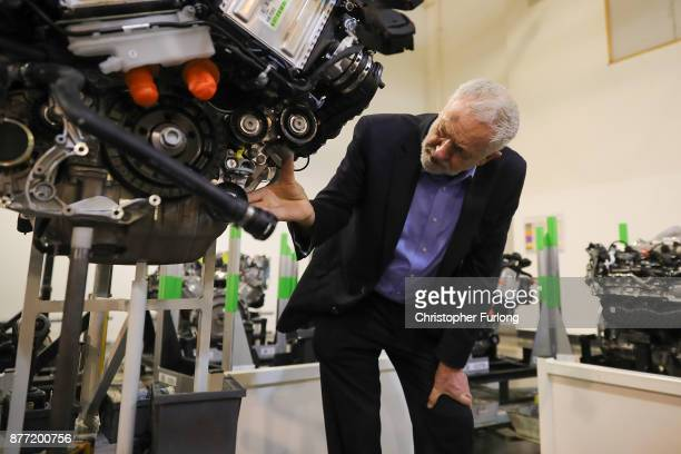 Labour Leader Jeremy Corbyn looks at an engine during a visit to luxury car maker Aston Martin on November 16 2017 in Warwick England Jeremy Corbyn...