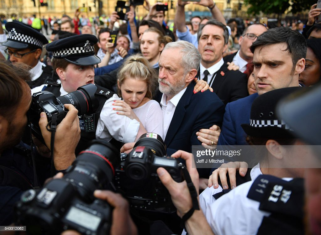 Labour leader <a gi-track='captionPersonalityLinkClicked' href=/galleries/search?phrase=Jeremy+Corbyn&family=editorial&specificpeople=2596361 ng-click='$event.stopPropagation()'>Jeremy Corbyn</a> makes his way through the crowd to delvier a speech during Momentum's 'Keep Corbyn' rally outside the Houses of Parliament on June 27, 2016 in London, England. The Labour Leader has seen mass resignations from the Shadow Cabinet in the wake of the UK Vote for Brexit. His support group, Momentum, have recorded more than 1000 new members in the same period.