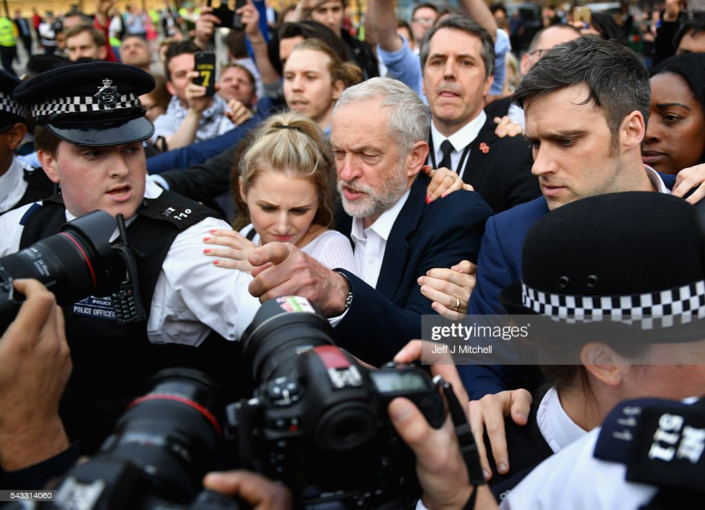 Labour leader <a gi-track='captionPersonalityLinkClicked' href=/galleries/search?phrase=Jeremy+Corbyn&family=editorial&specificpeople=2596361 ng-click='$event.stopPropagation()'>Jeremy Corbyn</a> makes his way through the crowd to deliver a speech during Momentum's 'Keep Corbyn' rally outside the Houses of Parliament on June 27, 2016 in London, England. The Labour Leader has seen mass resignations from the Shadow Cabinet in the wake of the UK Vote for Brexit. His support group, Momentum, have recorded more than 1000 new members in the same period.
