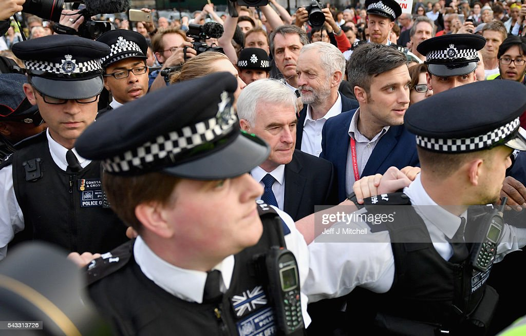 Labour Leader <a gi-track='captionPersonalityLinkClicked' href=/galleries/search?phrase=Jeremy+Corbyn&family=editorial&specificpeople=2596361 ng-click='$event.stopPropagation()'>Jeremy Corbyn</a> makes his way through the crowd with Shadow Chancellor of the Exchequer <a gi-track='captionPersonalityLinkClicked' href=/galleries/search?phrase=John+McDonnell+-+Politician&family=editorial&specificpeople=15046200 ng-click='$event.stopPropagation()'>John McDonnell</a> during Momentum's 'Keep Corbyn' rally outside the Houses of Parliament on June 27, 2016 in London, England. The Labour Leader has seen mass resignations from the Shadow Cabinet in the wake of the UK Vote for Brexit. His support group, Momentum, have recorded more than 1000 new members in the same period.