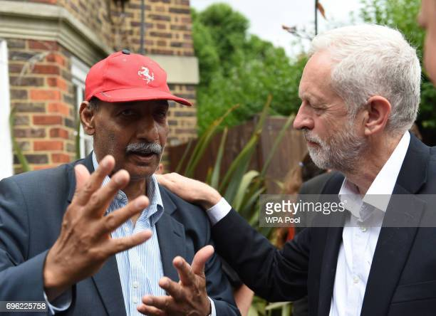 Labour leader Jeremy Corbyn meets councillor Mushtaq Lasharie as he arrives at St Clement's Church in west London where volunteers have provided...