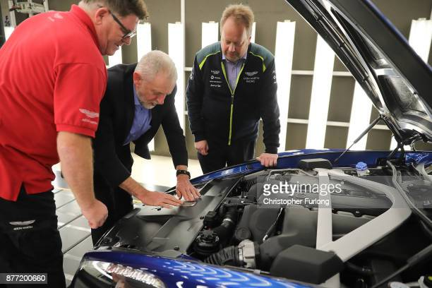 Labour Leader Jeremy Corbyn places the final inspection plate on the engine of a DB11 with Andy Palmer CEO of Aston Martin and quality inspector...