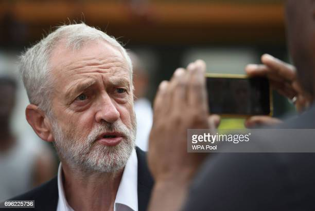 Labour leader Jeremy Corbyn poses for a photograph as he arrives at St Clement's Church in west London where volunteers have provided shelter and...