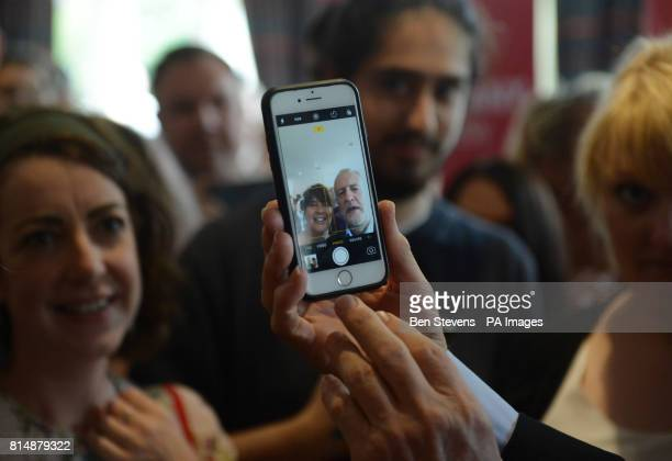 Labour leader Jeremy Corbyn poses for a selfie with a supporter at the Bournemouth West Cliff Hotel during a visit to Bournemouth