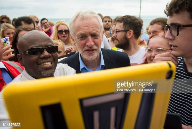 Labour leader Jeremy Corbyn poses for a selfie with supporters as he visits the West Cliff area of Bournemouth for a walk along the beach that was...